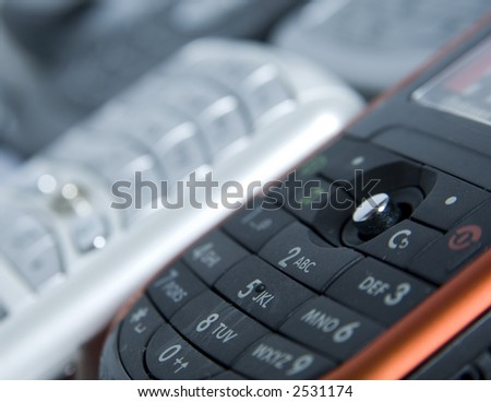 A close-up shot of a row of mobile phones (very shallow depth of field)