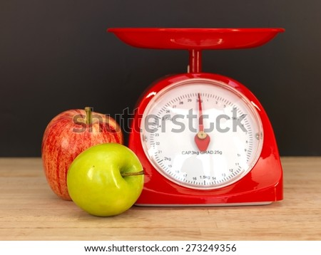 A close up shot of a set of food scales - stock photo