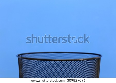 A close up shot of a trash can - stock photo