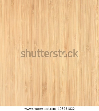 A close up shot of a wooden chopping board - stock photo