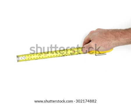 A close up shot of a workshop measuring tape - stock photo