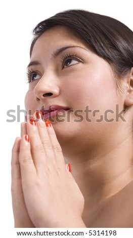 A close up shot of a young girl praying over a white background