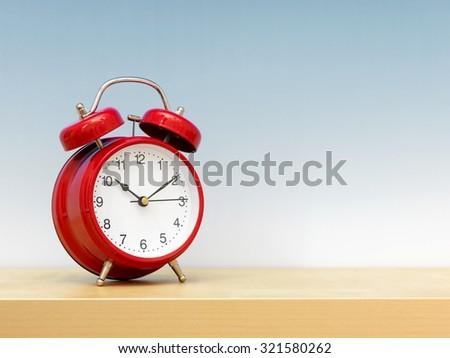 A close up shot of an analogue clock - stock photo