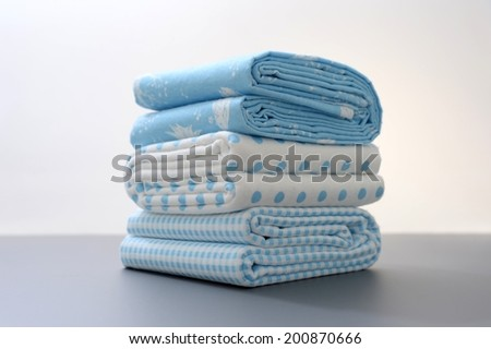 A close up shot of baby bed sheets - stock photo