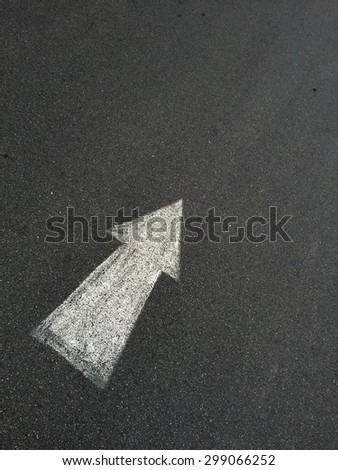 A close up shot of road markings arrow - stock photo