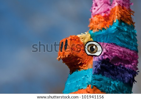 A close up shot of the head of a festive pinata. - stock photo
