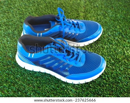 A close up shot sneakers on artificial grass - stock photo