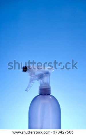A close up studio photo of a cleaning spray bottle - stock photo