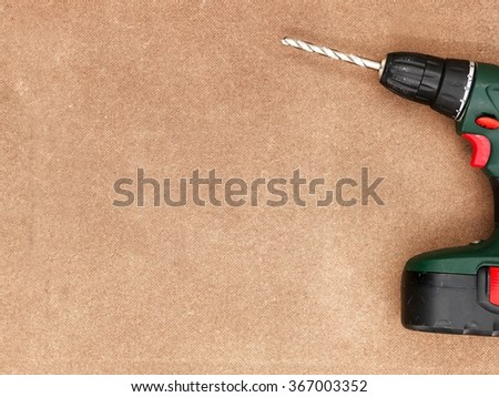 A close up studio photo of a cordless rechargable drill - stock photo