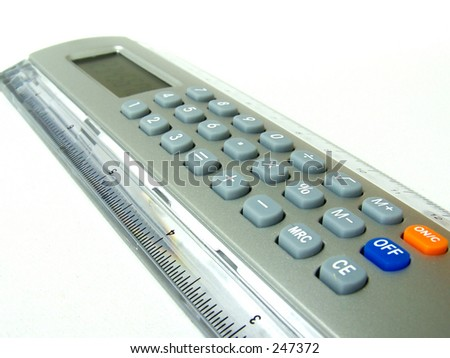A close up view a ruler with calculator function. - stock photo
