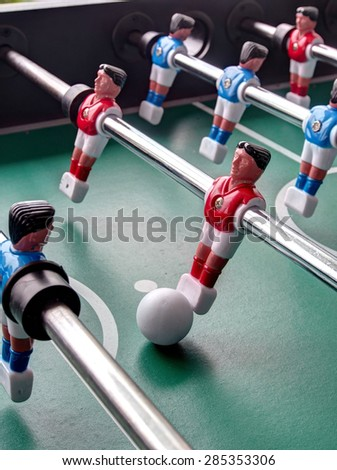A close-up view of a Foosball table