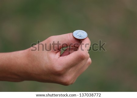 A close up view of someone about to flip American currency - stock photo