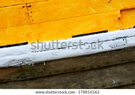 A close up view of the paint on a wooden boat