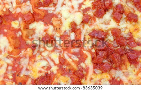 A close view of a cooked pepperoni pizza.