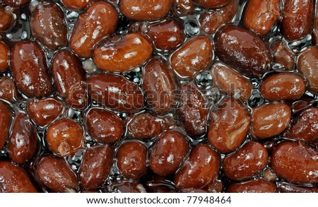 A close view of canned black beans in liquid. - stock photo
