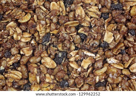 A close view of the top of a chewy granola bar. - stock photo