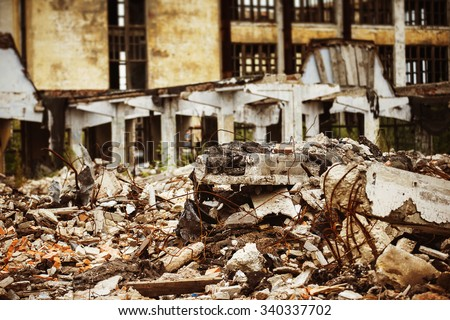 A closeup image of a garbage dump with ruined brick and wooden planks. Concept of disaster, war. - stock photo