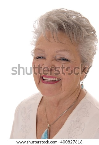 A closeup image of a smiling senior citizen woman in her seventies withshort grey hair isolated for white background. - stock photo
