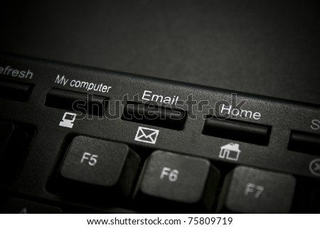 A closeup image of an Email Key on a Keyboard. - stock photo