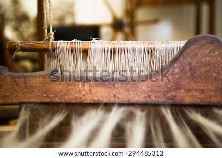 A closeup image of an old weaving Loom, details. - stock photo