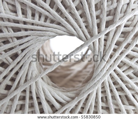 a closeup macro image looking through the centre of a ball of string - stock photo