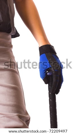 A closeup of a baseball player with a  batters glove holding his bat casually - stock photo