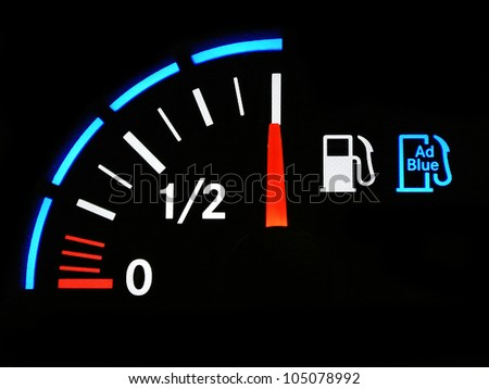 A closeup of a car , truck fuel gauge with ad blue