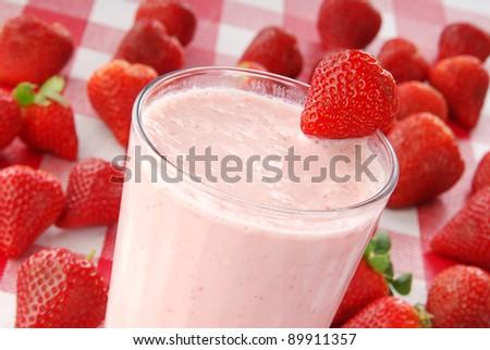 A closeup of a fresh strawberry yogurt smoothie - stock photo