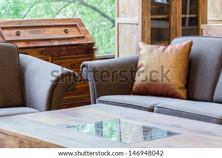 A closeup of a living room with couches and a coffee table - stock photo