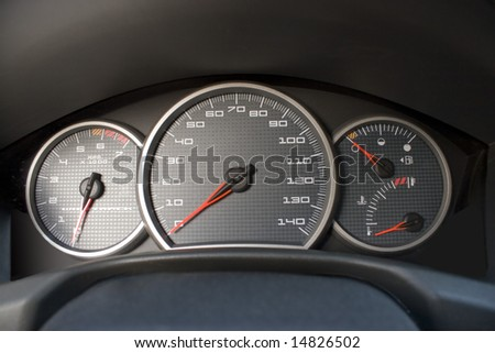 A closeup of a modern car interior - the dashboard.  This is the drivers cockpit. - stock photo