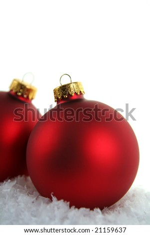 A closeup of a pair of red Christmas baubles closeup.