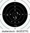 A Closeup of a practice target used for shooting with bullet holes in it. - stock photo