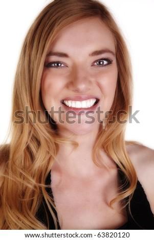 A closeup of a smiling woman. - stock photo