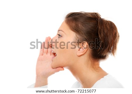 A closeup of a young girl whispering over white background - stock photo