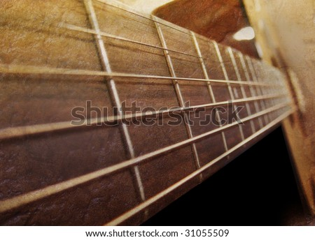 A closeup of an acoustic guitar strings going downward. The color uses a brown palette and there are dark shadows. - stock photo