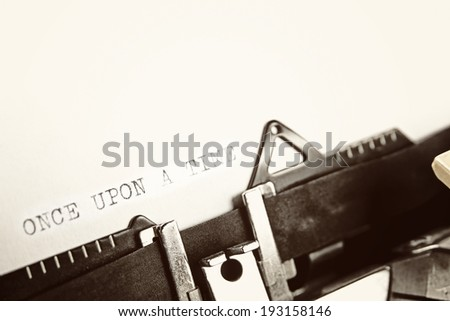 "A closeup of an old fashioned typewriter with the words ""ONCE UPON A TIME"" clearly visible. - stock photo"