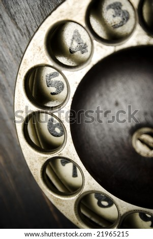 a closeup of an old phone dialing ring - stock photo