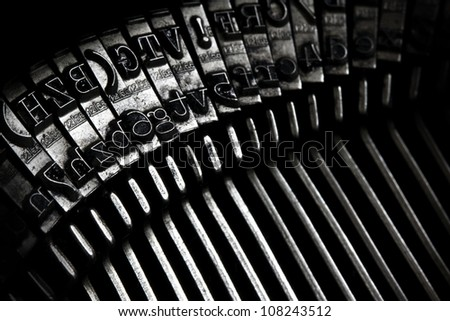 a closeup of an old typewriter keys - stock photo