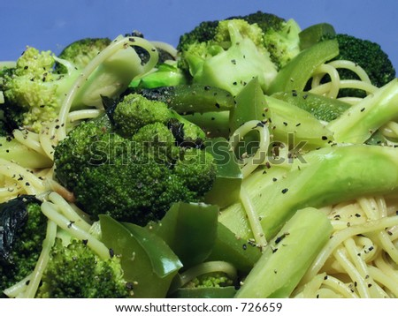 A closeup of broccoli, green peppers, and pasta. - stock photo