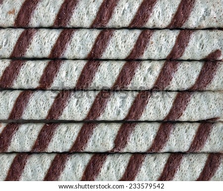 A closeup of chocolate striped wafer rolls - stock photo