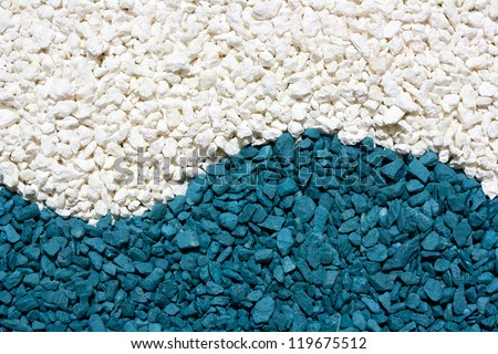 A closeup of colorful white and blue stones sand - stock photo