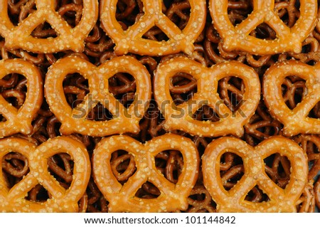 A Closeup of Large Sourdough Pretzels on a bed of smaller pretzels. Fills the Frame.