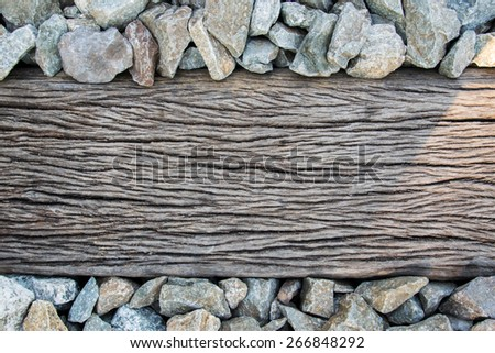 A closeup of some weathered railroad tracks. - stock photo