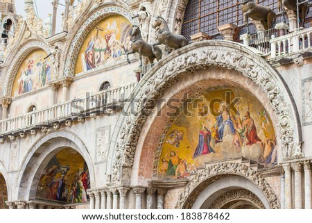 A closeup of  the ornate outer architecture and paintings of Saint Mark's Basilica in Venice, Italy - stock photo