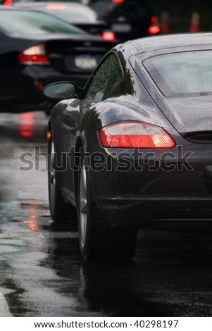 A closeup of the rear tail light on a modern sports car. - stock photo