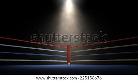 A closeup of the red corner of a regular boxing ring surrounded by ropes spotlit by a spotlight on an isolated dark background - stock photo