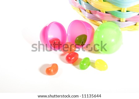 A Closeup Of Two Plastic Easter Eggs On White Background In Front An