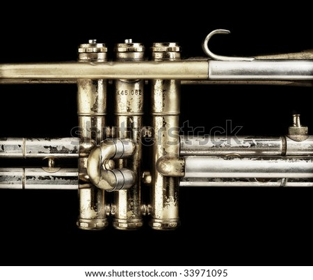 A closeup of well used and played trumpet valves.