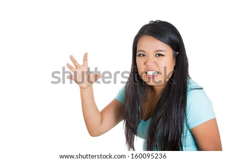 A closeup portrait of a beautiful stressed angry mad woman threatening someone with her claws , nails, isolated on a white background with copy space