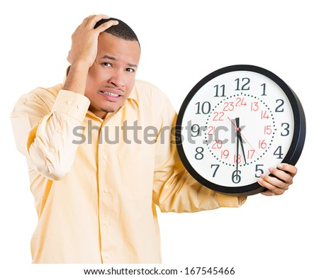A closeup portrait of a business man, student, leader holding a clock very stressed, pressured by lack of time, running out of time, late for the meeting, isolated on a white background. Emotions - stock photo